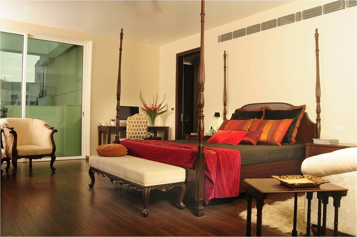 Vintage Themed Bedroom With Red and Orange Details by Ram Malhotra Bedroom Vintage | Interior Design Photos & Ideas