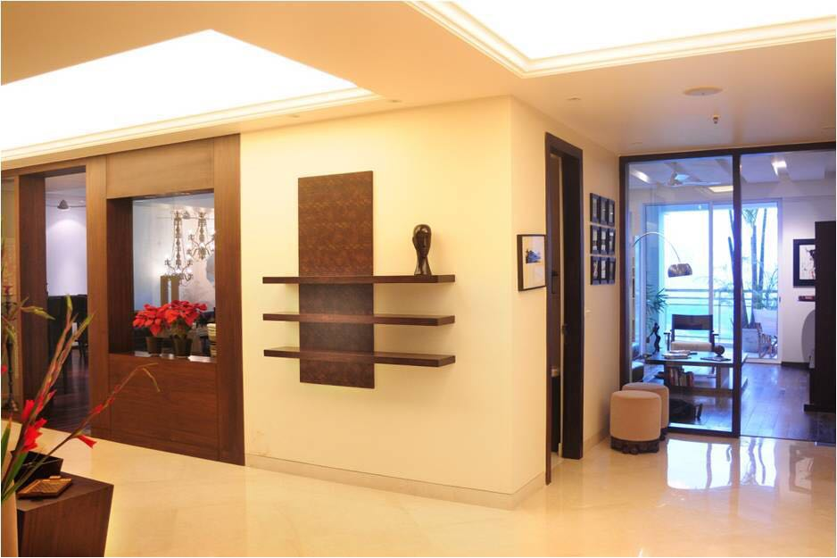 Beige Themed Living Room With Wooden Display Shelf by Ram Malhotra Living-room Modern | Interior Design Photos & Ideas