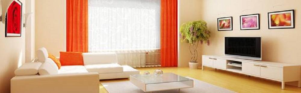 Orange themed living room decor by eb+D Living-room | Interior Design Photos & Ideas