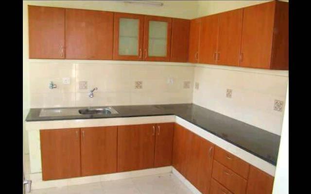 L shaped kitchen by Amaze interiors.chennai Modular-kitchen | Interior Design Photos & Ideas