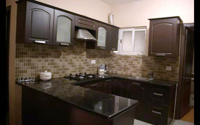 U shaped kitchen by Amaze interiors.chennai Modular-kitchen | Interior Design Photos & Ideas