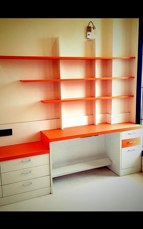 Study Room With Orange Detailing by Neeti Thakur