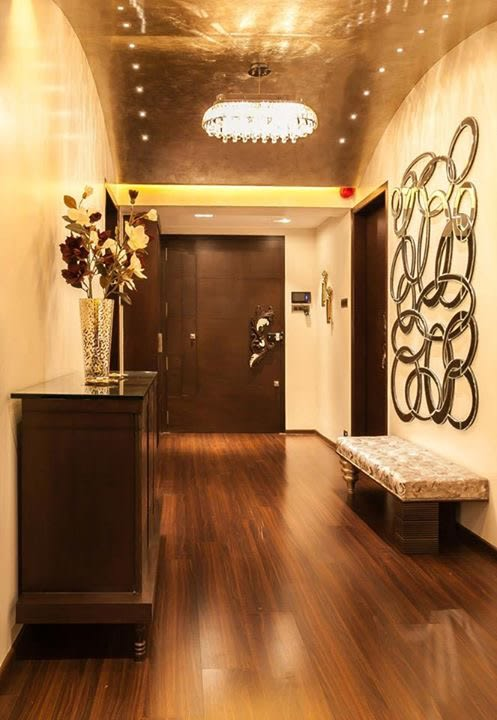 Plush wooden finish entrance by Blue Arch Interiors Indoor-spaces | Interior Design Photos & Ideas