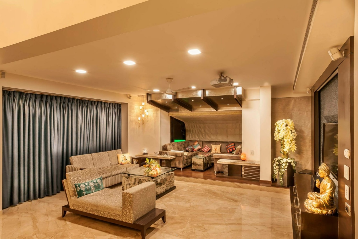 Regal gold theme living room decor by Blue Arch Interiors Living-room | Interior Design Photos & Ideas