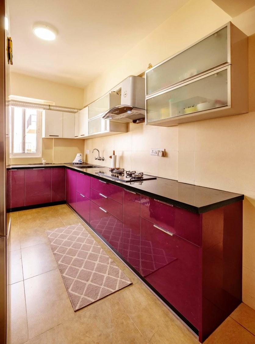 Maroon L shaped  kitchen by Mehul Diwani Modular-kitchen   Interior Design Photos & Ideas