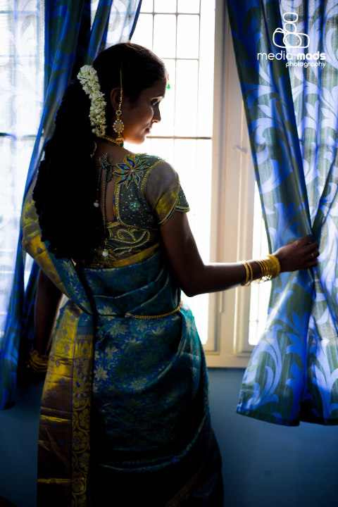 A exquisite portrait of the bride standing by the window by Media Mads Wedding-photography | Weddings Photos & Ideas