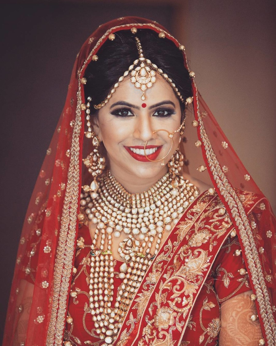 Ravishing Bride In Golden Polki Kundan Jewellery by Akshat Mongia Bridal-makeup Bridal-jewellery-and-accessories | Weddings Photos & Ideas