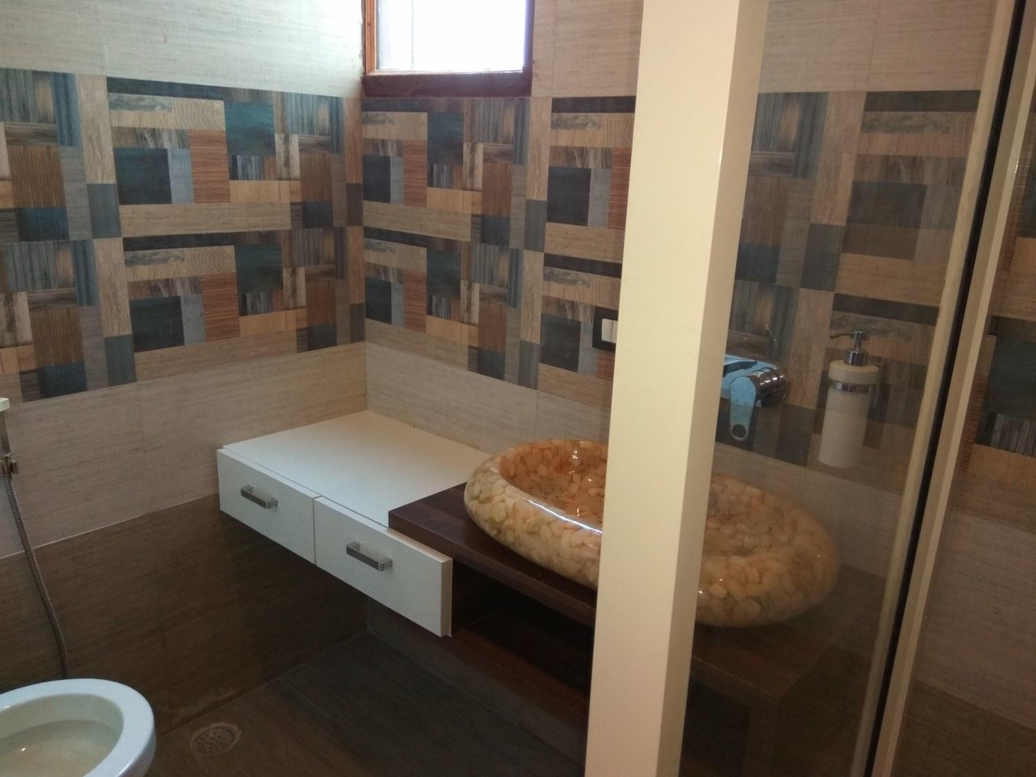 Compact bathroom with white drawer top and granite basin by Mehru Dua Bathroom Contemporary | Interior Design Photos & Ideas