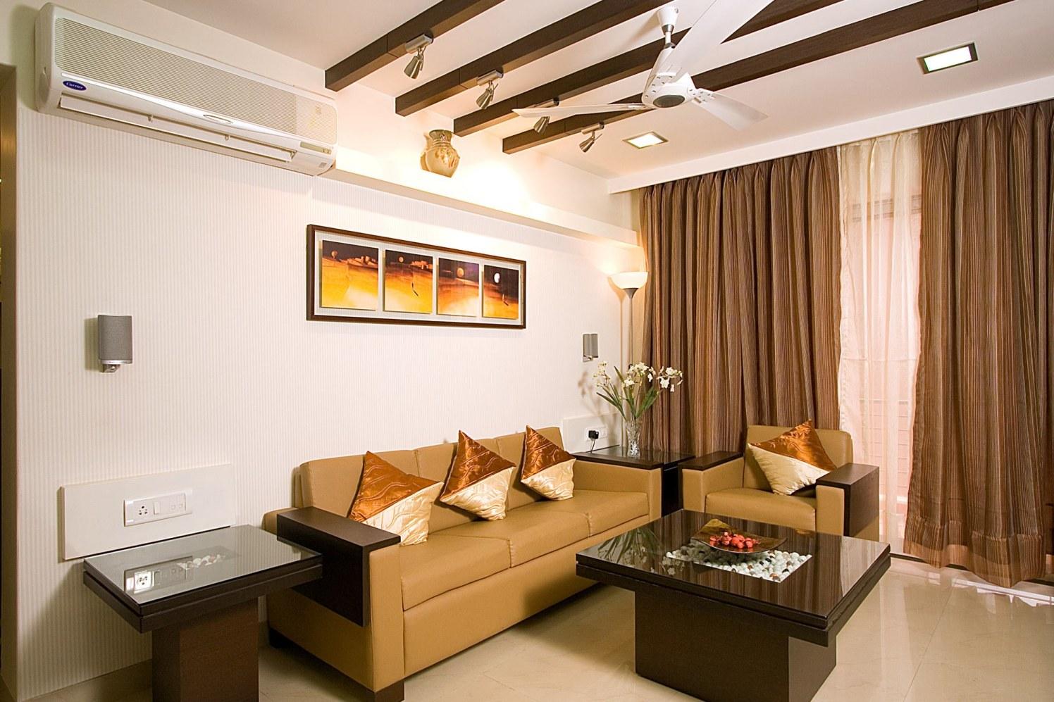Beige Living Room With Shiny Cushions by Vikas Bhoir Living-room Contemporary | Interior Design Photos & Ideas