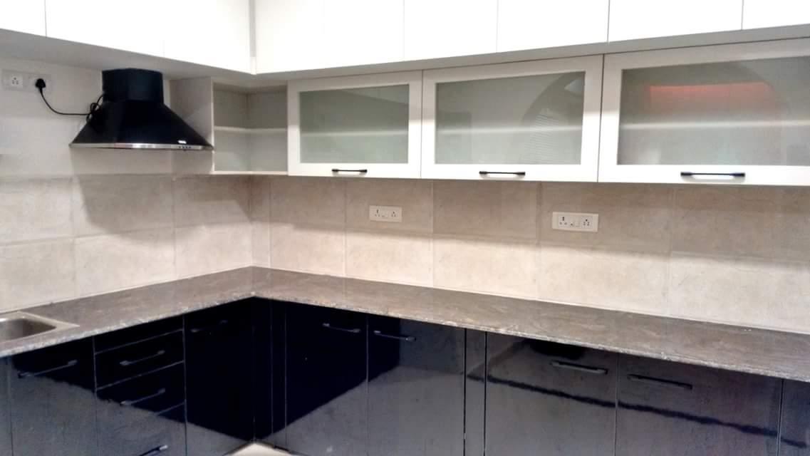 L-shaped modular kitchen by Unbox Design Studio Modular-kitchen Modern   Interior Design Photos & Ideas