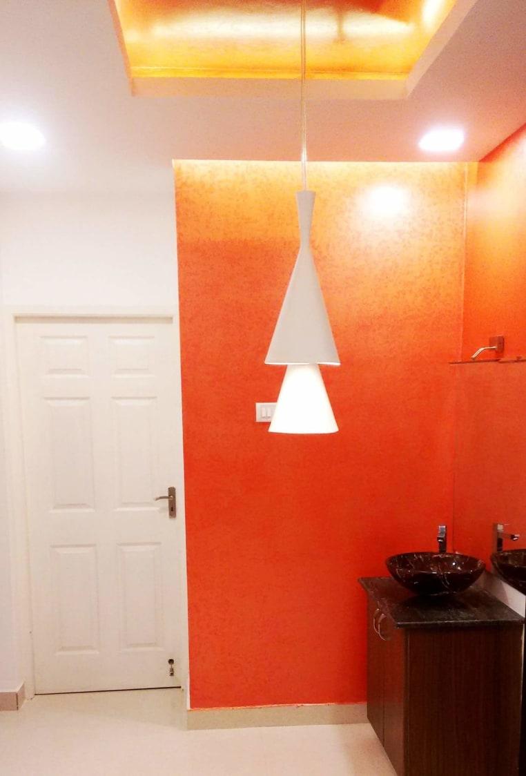 Orange themed modern bathroom decor by Unbox Design Studio Bathroom Modern | Interior Design Photos & Ideas
