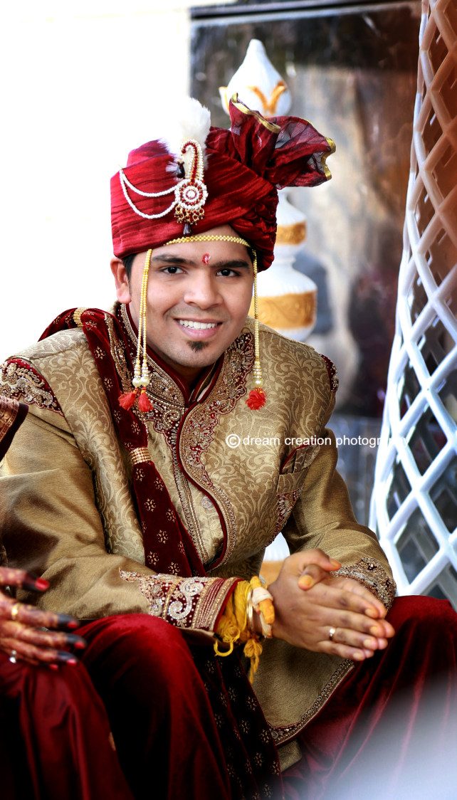 A smiling portrait of the groom by Dream creation Omerga Wedding-photography | Weddings Photos & Ideas