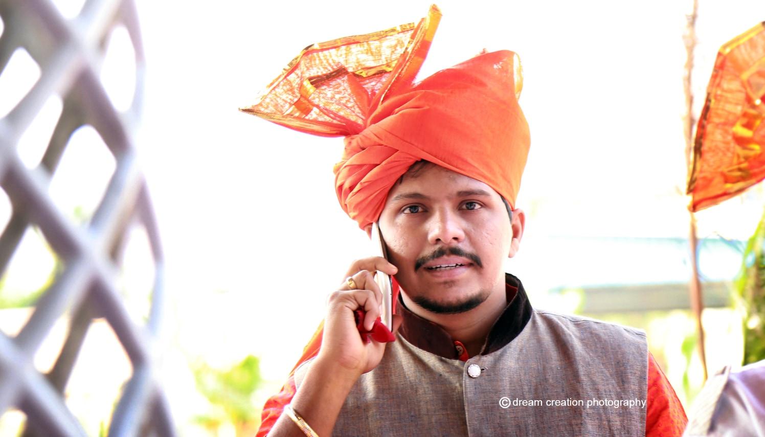 A wedding guest on the phone by Dream creation Omerga Wedding-photography | Weddings Photos & Ideas