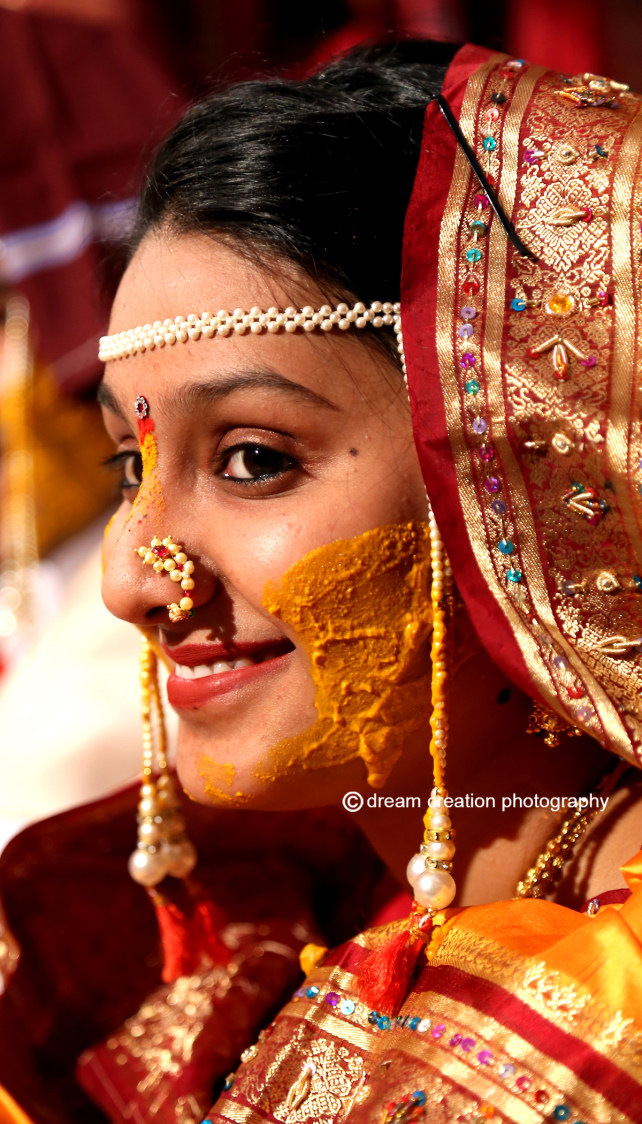 Bride during her haldi ceremony by Dream creation Omerga Wedding-photography | Weddings Photos & Ideas