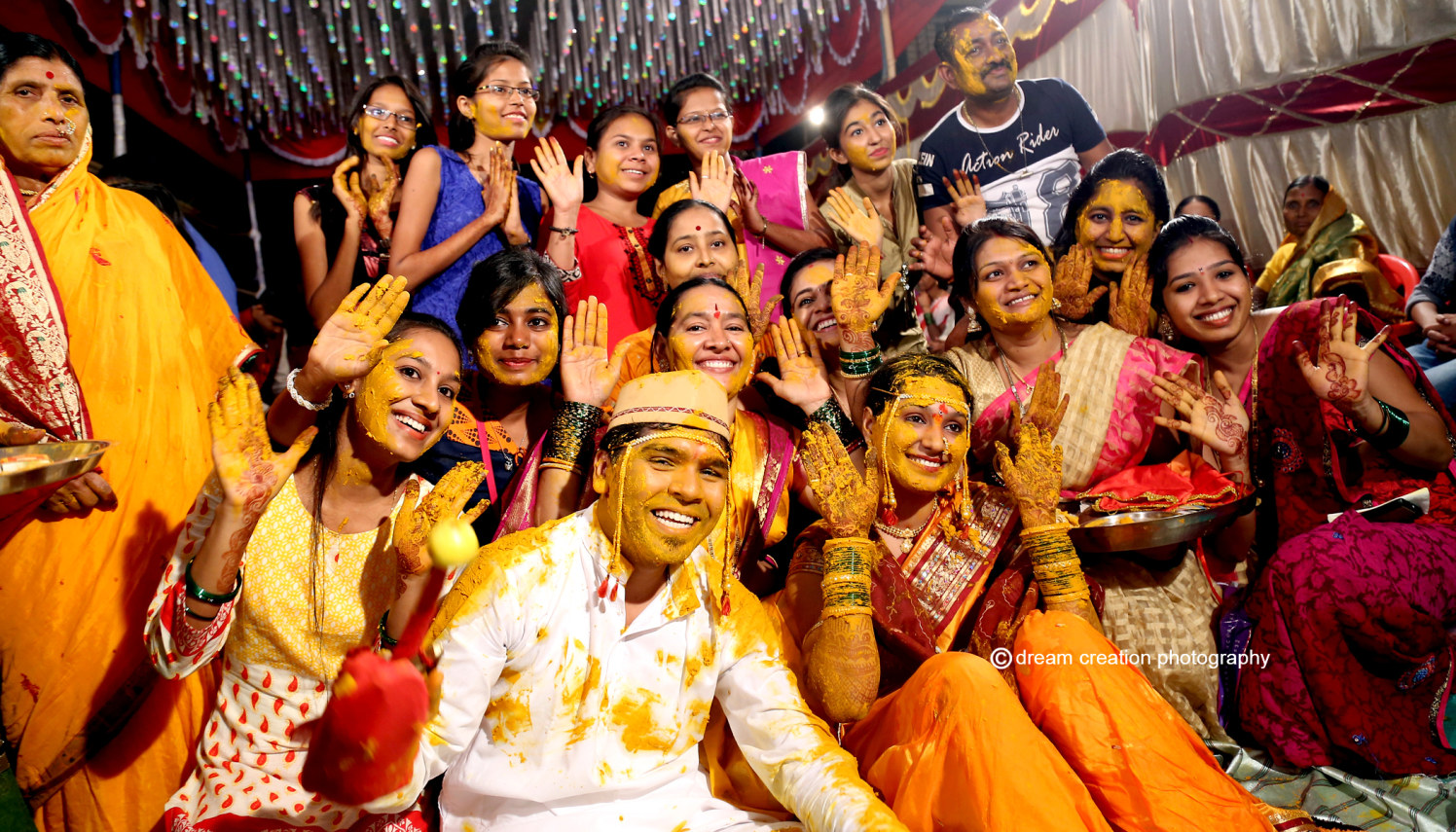 Happy Family covered in haldi by Dream creation Omerga Wedding-photography | Weddings Photos & Ideas