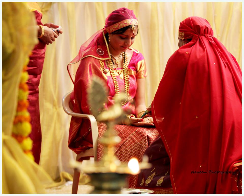 Bride during her mehendi ceremony by Naveen Photography Wedding-photography | Weddings Photos & Ideas