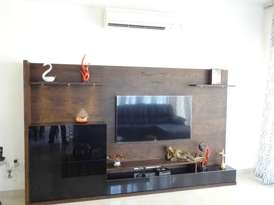 Wooden Television Cabinet With Leaning Golden Buddha by Snigdha Ghosh Living-room Contemporary | Interior Design Photos & Ideas