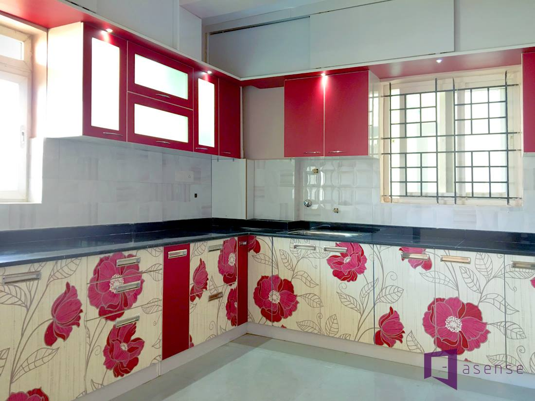 The kitchen with red by Asense Interior