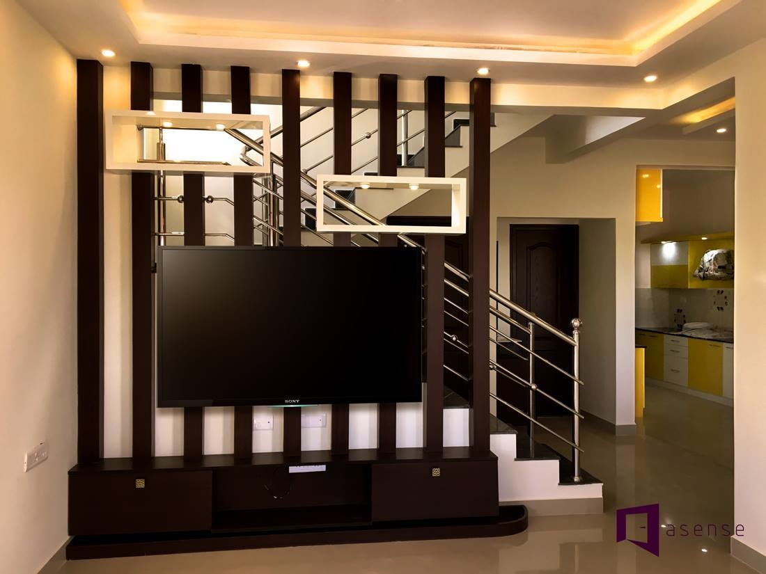Simple Staircase With Metallic Railings by Snigdha Ghosh Indoor-spaces | Interior Design Photos & Ideas