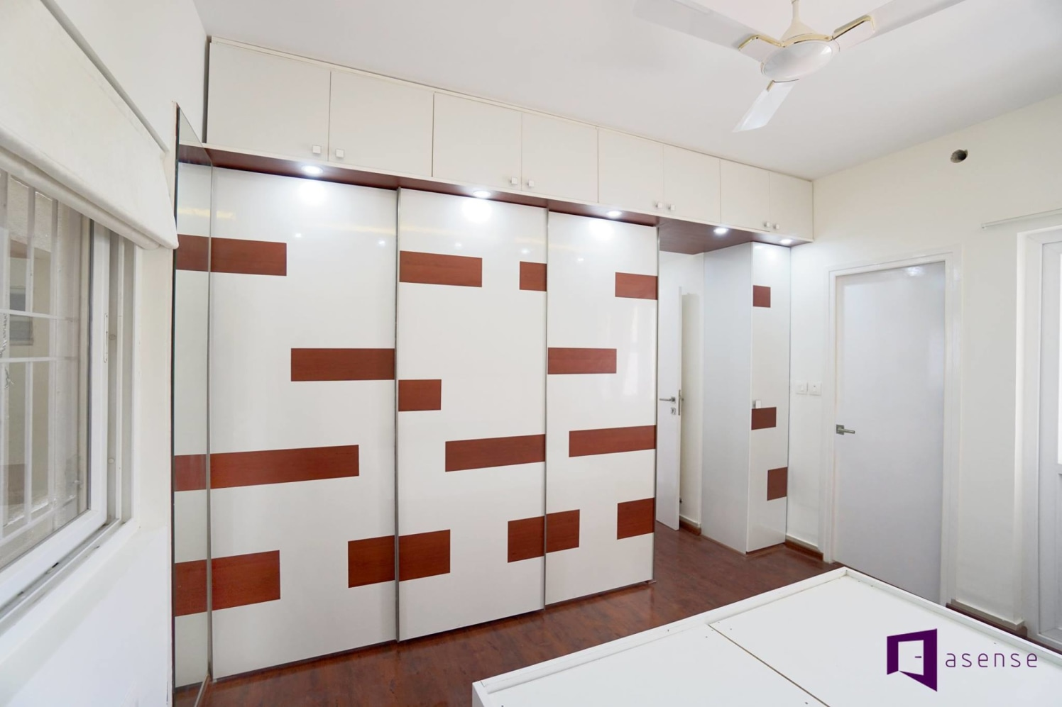 White Wardrobe With Brown Strips by Snigdha Ghosh Bedroom Contemporary | Interior Design Photos & Ideas