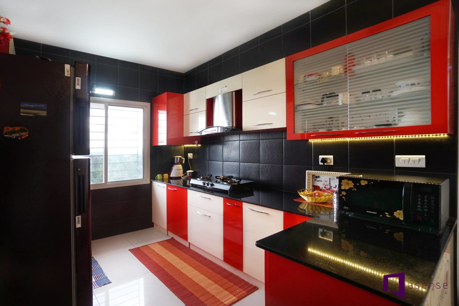 Red And White Themed Modular Kitchen with Black Marbles by Snigdha Ghosh Modular-kitchen Contemporary | Interior Design Photos & Ideas