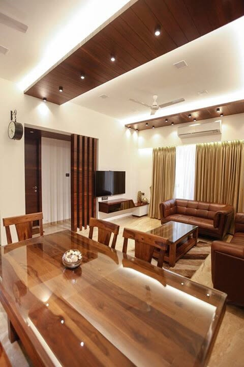 Wood finish living room decor by Artistic Illusions Living-room Modern | Interior Design Photos & Ideas