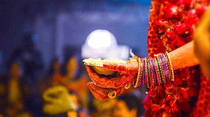 The bride indulging in the wedding customs by Creative Films Photography and Events Wedding-photography | Weddings Photos & Ideas