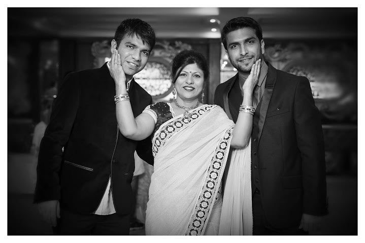 Groom Posing With His Family by Himanshu Chauhan Wedding-photography | Weddings Photos & Ideas