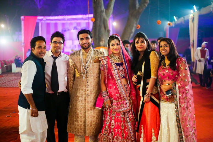 Bride and Groom Posing With Their Friends by Himanshu Chauhan Wedding-photography   Weddings Photos & Ideas