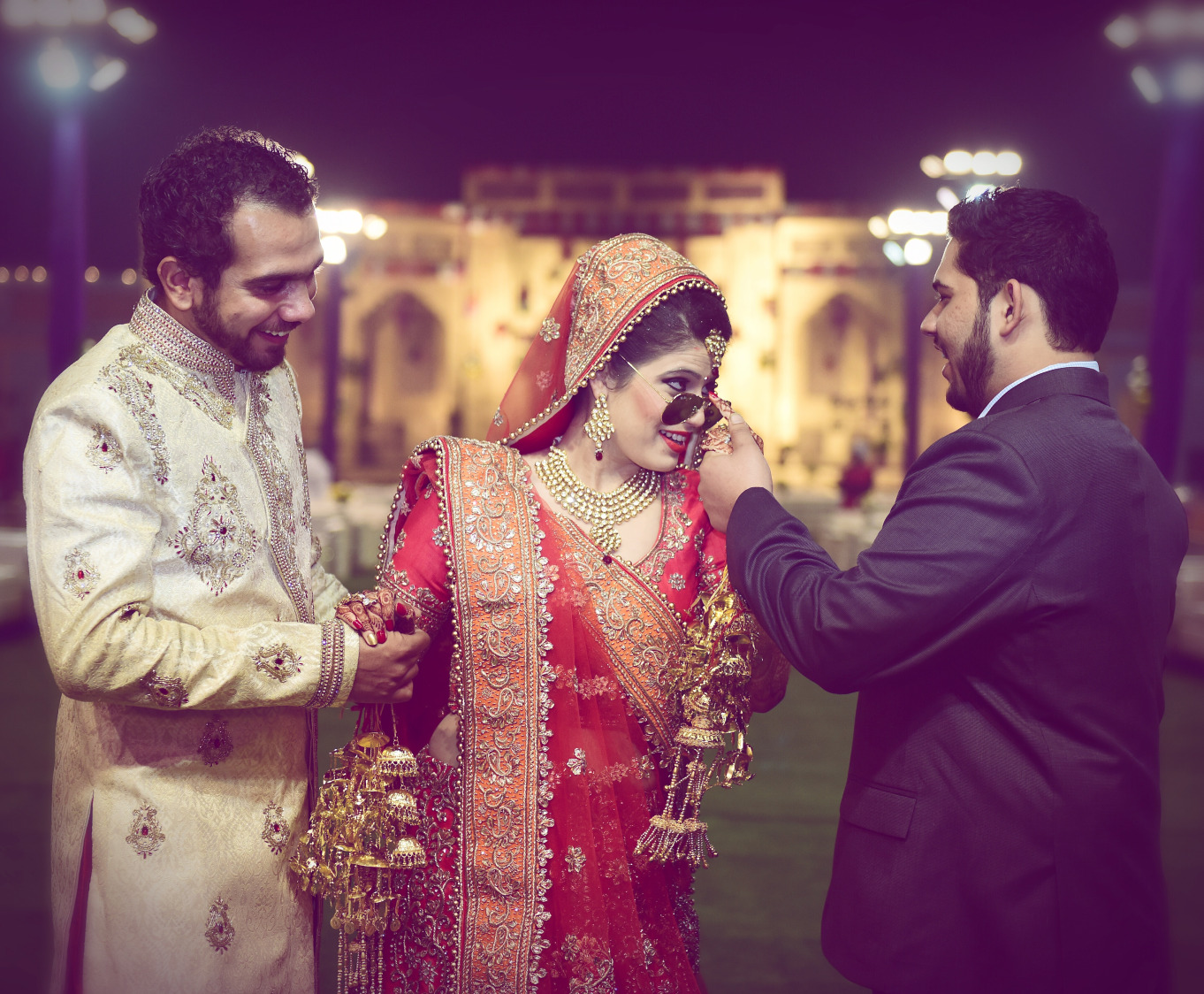 Bride Striking a Cool Pose With Wedding Guests by Himanshu Chauhan Wedding-photography | Weddings Photos & Ideas