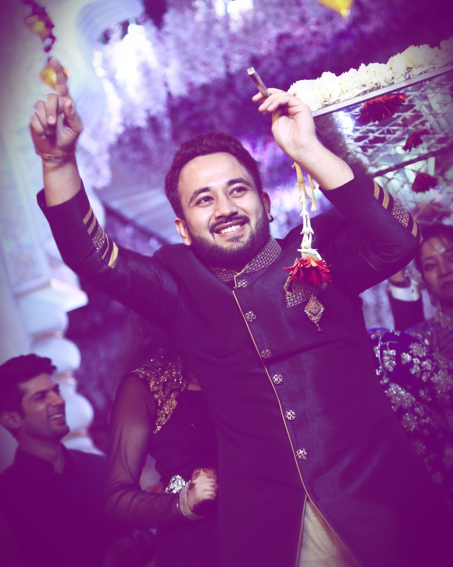 Happy groom during reception by Himanshu's Lomography Wedding-photography | Weddings Photos & Ideas