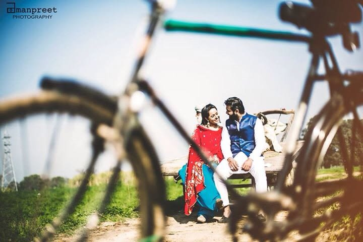Bride and Groom To-Be Pose With Bicycle Prop by Amanpreet Kaur Wedding-photography | Weddings Photos & Ideas