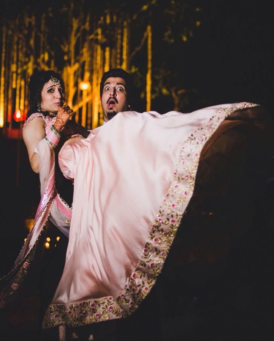 Bride and Groom Strike a Funny Pose by Amanpreet Kaur Wedding-photography | Weddings Photos & Ideas