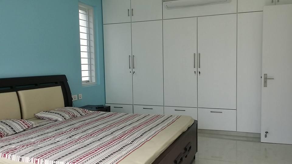 A Cozy  Bedroom With White Wardrobe by Craftmen Studio Bedroom Contemporary | Interior Design Photos & Ideas