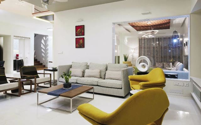 The off white sofa set by Aamantran Living-room | Interior Design Photos & Ideas
