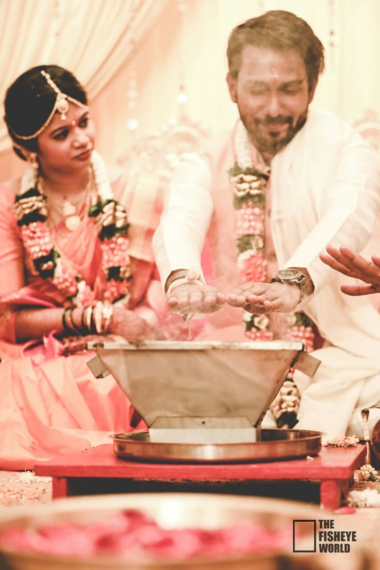 Gorgeous couple performing rituals by The Fisheye world institute of photography and studios Wedding-photography | Weddings Photos & Ideas