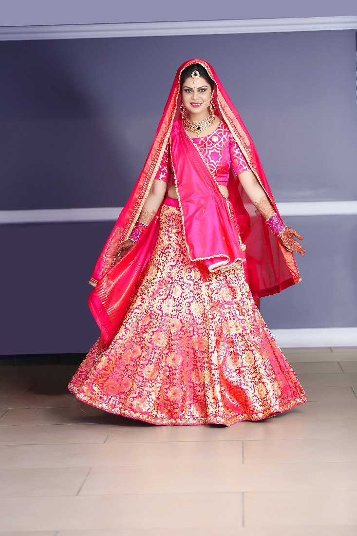 Bride Wearing A Pink Lehenga With Gold Work by Mukesh bijalwan  Wedding-photography Wedding-dresses | Weddings Photos & Ideas
