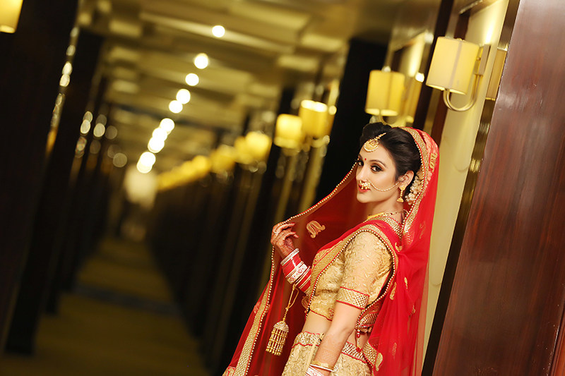 Bride Wearing A Red And Gold Bridal Lehenga by Mukesh bijalwan  Wedding-photography | Weddings Photos & Ideas
