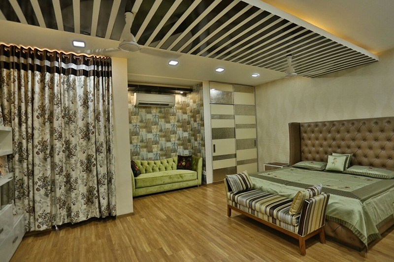 Bedroom WIth Wooden Flooring And False Ceiling With Black And White Stripes by Damanjit Bajaj  Bedroom Contemporary | Interior Design Photos & Ideas