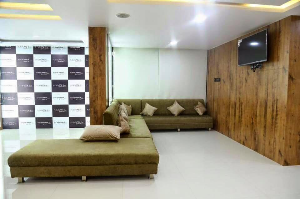 Green Sectional Sofa With Wooden Work by Kraftworks Pvt. Ltd. | Interior Design Photos & Ideas
