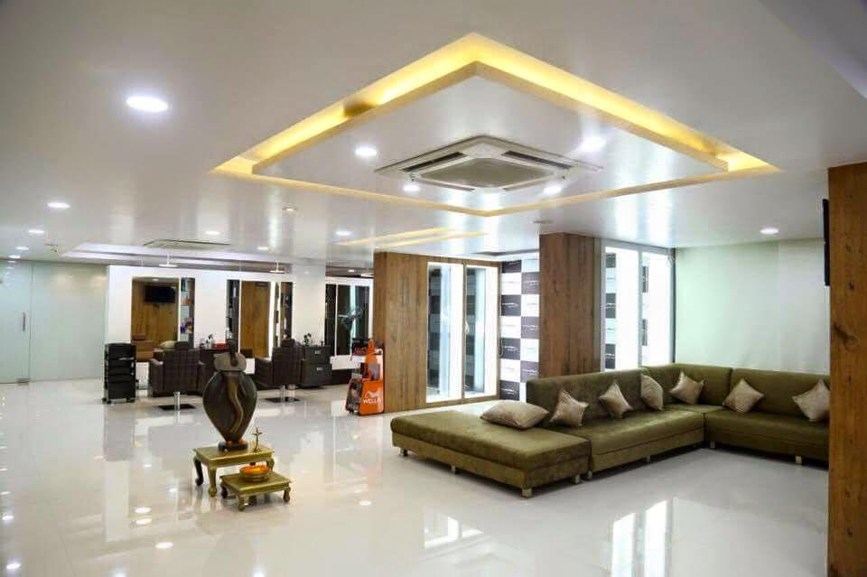 Green Velvet Sectional Sofa by Kraftworks Pvt. Ltd. | Interior Design Photos & Ideas