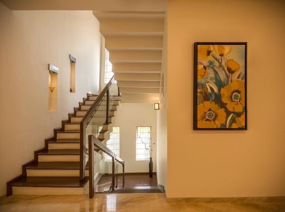Wooden Staircase With Floral Wall Art by Nilesh Jain Indoor-spaces Contemporary | Interior Design Photos & Ideas