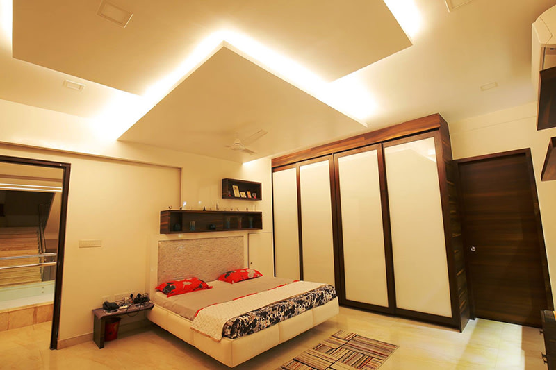 Cushioned Bed With Wooden Shifting Wardrobe by Nilesh Jain Bedroom Contemporary | Interior Design Photos & Ideas