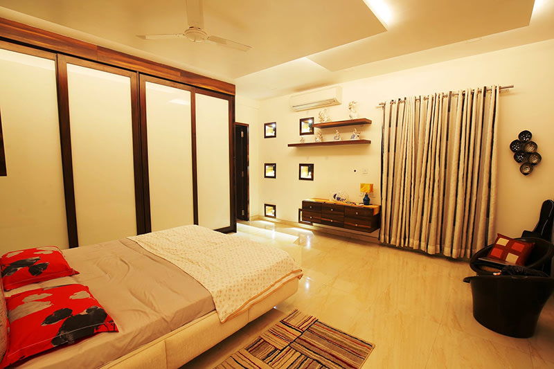 White Cushioned Bed With Shifting Wardrobe by Kraftworks Pvt. Ltd. Bedroom | Interior Design Photos & Ideas