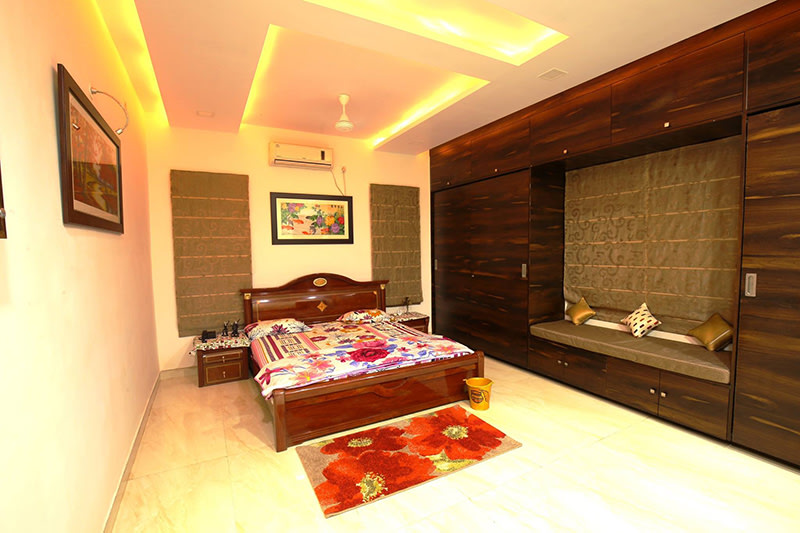 A standard master bedroom with marble flooring and false ceilings by Kraftworks Pvt. Ltd. Bedroom | Interior Design Photos & Ideas