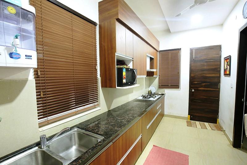 Parallel Wooden Kitchen by Kraftworks Pvt. Ltd. Modular-kitchen | Interior Design Photos & Ideas