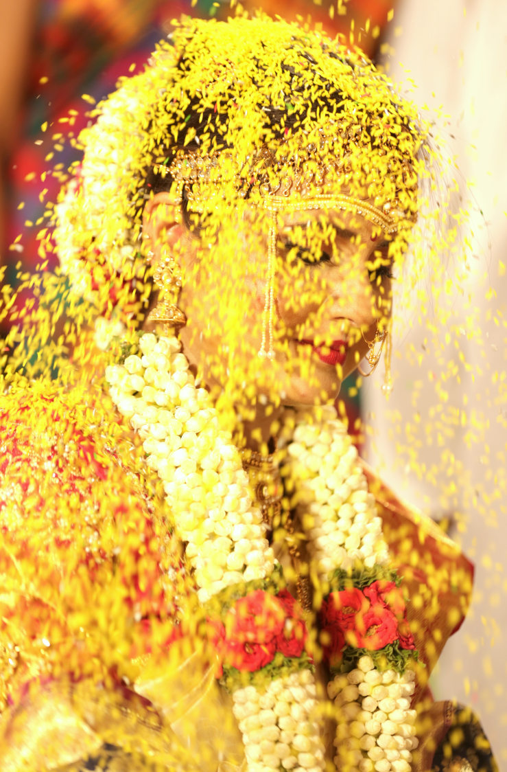 A stunning photo of bride who is showered by flowers! by Royale Photos Wedding-photography | Weddings Photos & Ideas