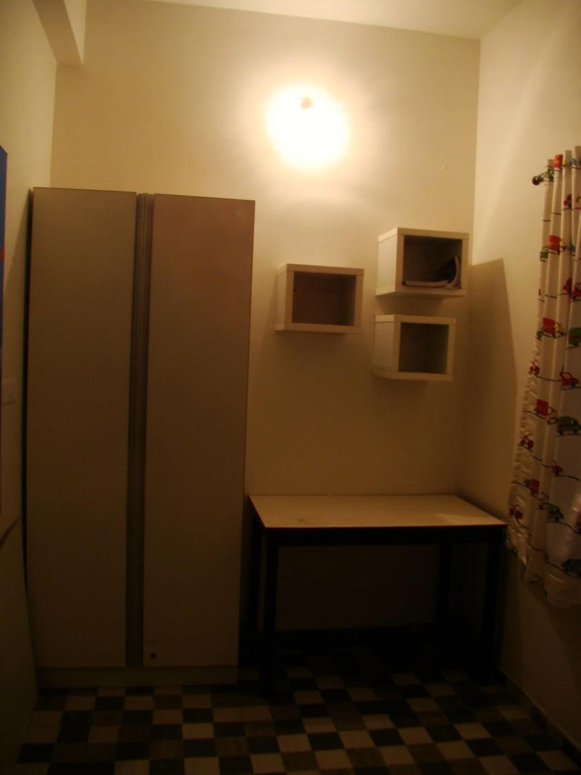 Wardrobe area in bedroom by Partha Ghosh Consultants  Bedroom Minimalistic | Interior Design Photos & Ideas