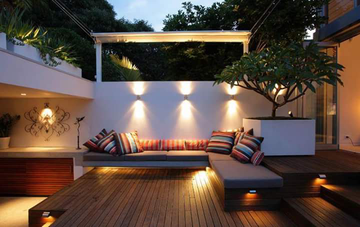 L Shape Sofa With Wooden Deck In A Balcony by Anjana Dhoot Open-spaces Contemporary | Interior Design Photos & Ideas