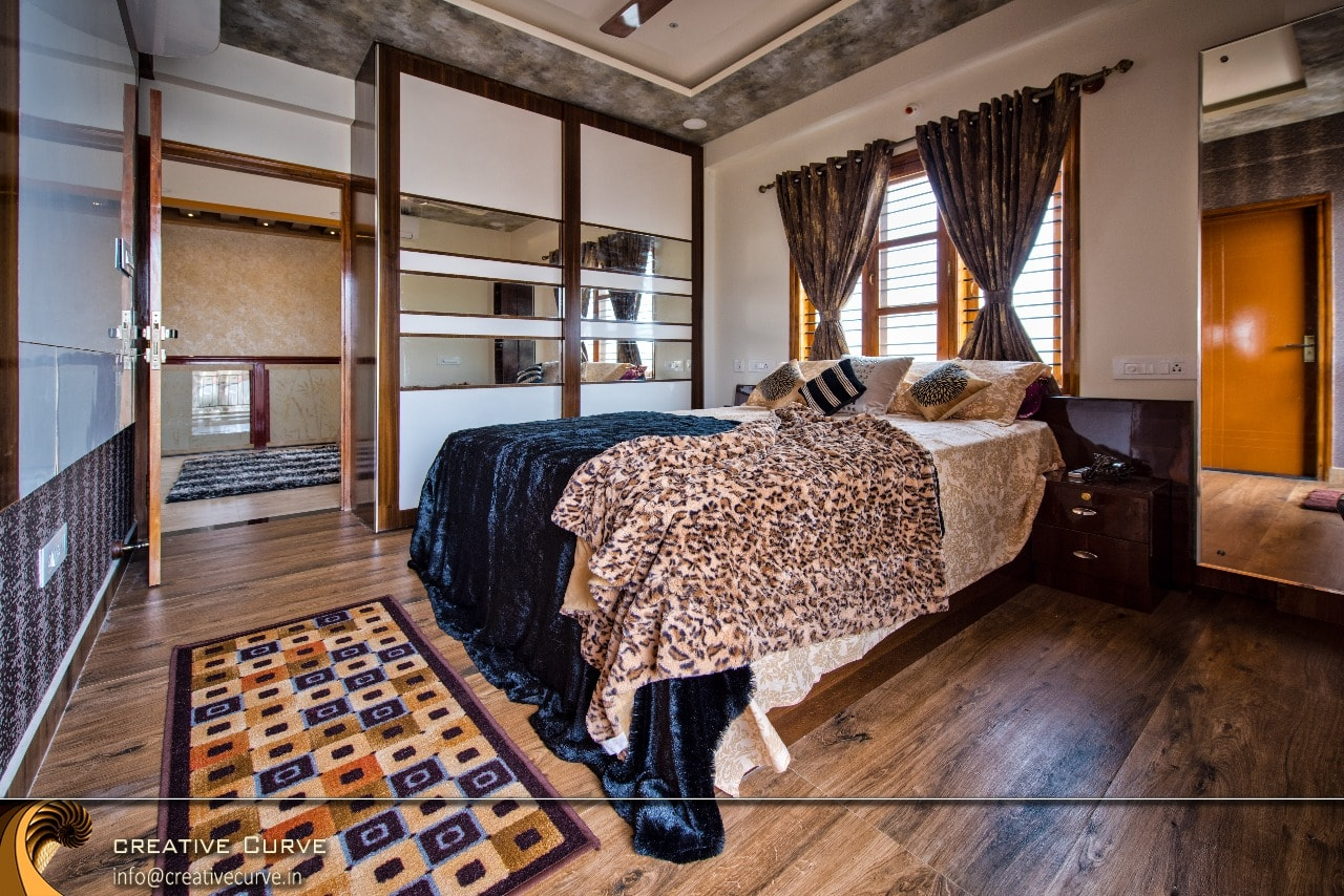 Wooden Bed With Animal Print Quilt And Carpet by Creative Curve Contemporary | Interior Design Photos & Ideas